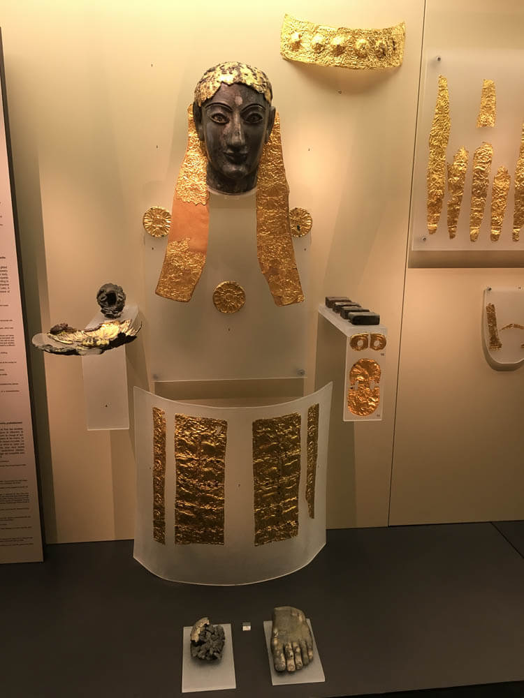 Remnants of a male statue of fire-blackened ivory representing Apollo